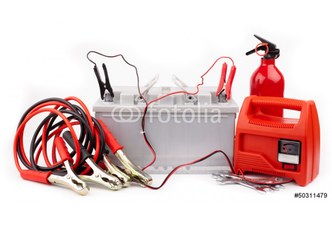Obraz nowoczesny Car battery and  jumper cables  isolated on white 64239