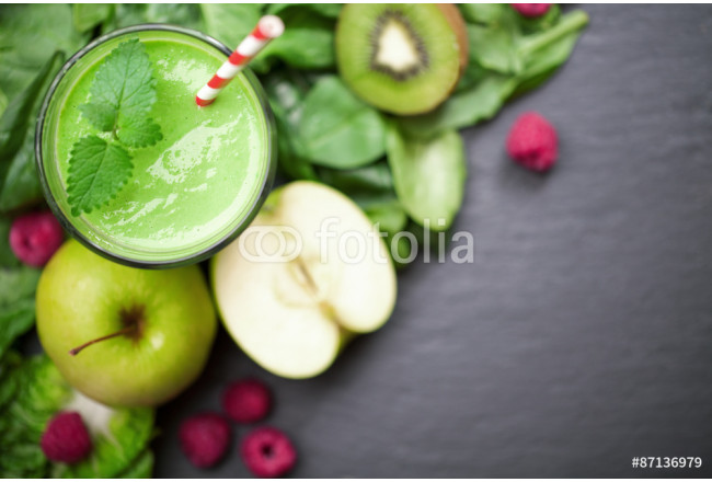 green smoothie with fruits and vegetables on black background 64239