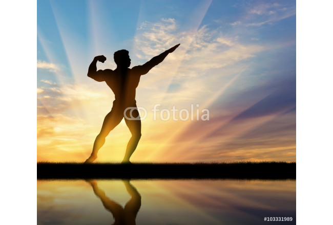 Silhouette of bodybuilder posing at sunset 64239