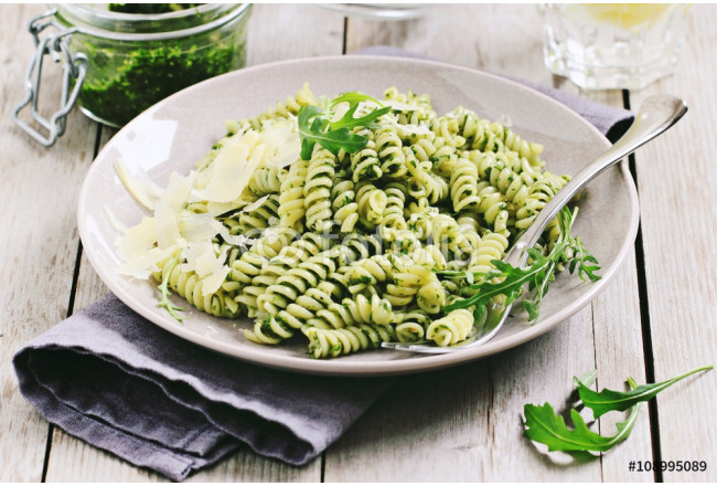 Pasta with pesto ,arugula and parmesan.Selective focus  64239