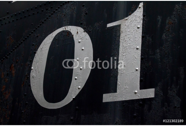 Number 01 on the side of an antique train car 64239