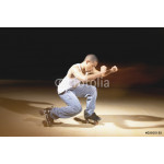 Young man performing dance on roller skates 64239