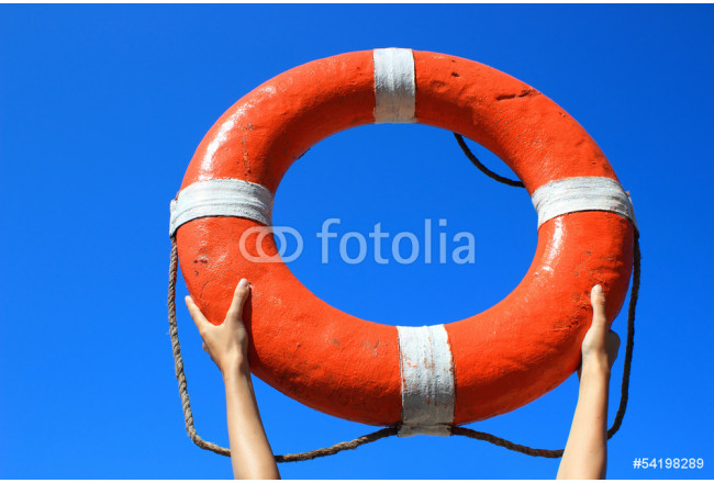 Red buoy in hands . Safety concept 64239