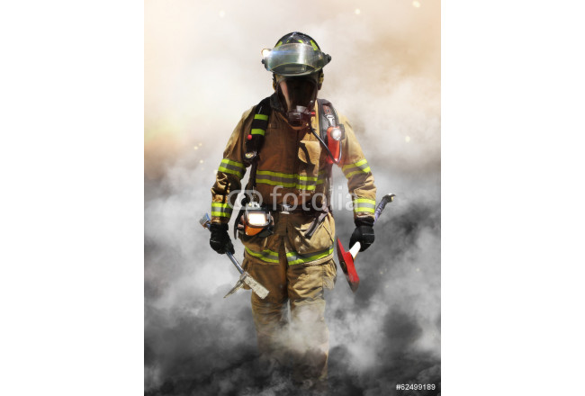 A firefighter pierces through a wall of smoke 64239