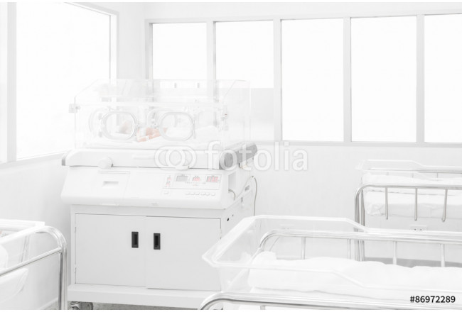 Newborn baby covered inside incubator in hospital post-delivery room 64239