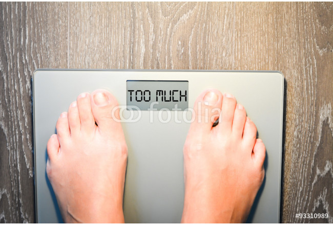 Lose weight concept with person on a scale measuring kilograms 64239