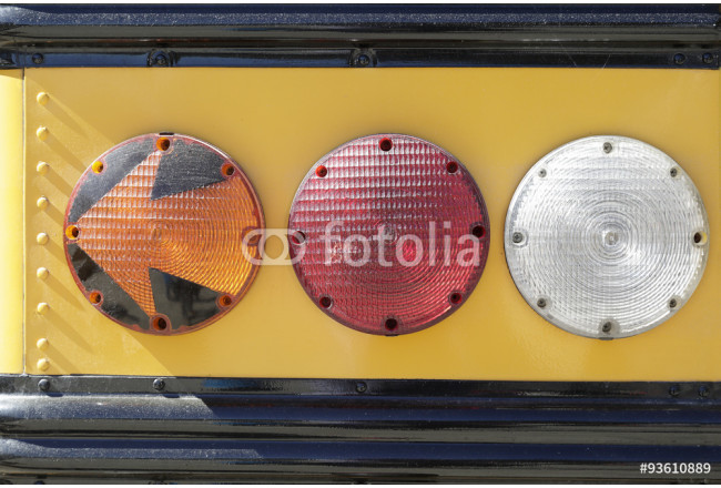 Rear lights of a traditional yellow school bus 64239
