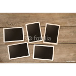 Empty instans album on wood table. paper photo of polaroid camera - vintage and retro style 64239