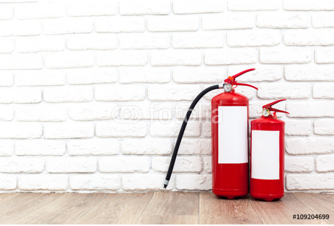 Fire extinguisher near white wall, ready for use 64239