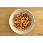 Almonds soaking in a bowl of water 64239