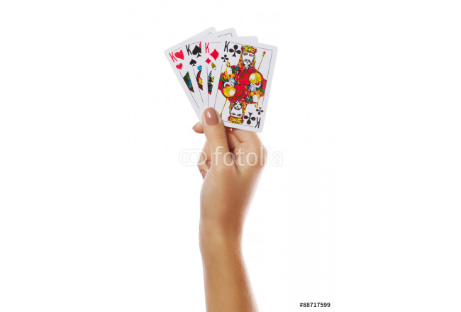 Playing cards in hand isolated on white background 64239